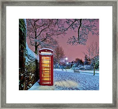 Red Phone Box Covered In Snow Framed Print by Photo by John Quintero