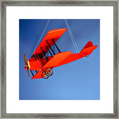 Red Plane On Blue Framed Print by Art Block Collections
