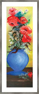 Red Poppies In A Blue Vase Framed Print