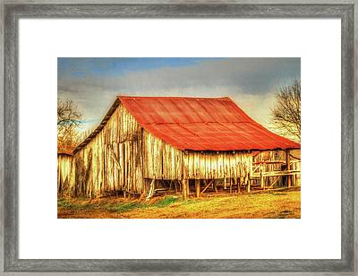 Red Roofed Barn Framed Print by Barry Jones