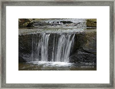 Red Run Waterfall Framed Print by Randy Bodkins
