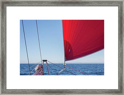 Framed Print featuring the photograph Red Sail On A Catamaran by Clare Bambers