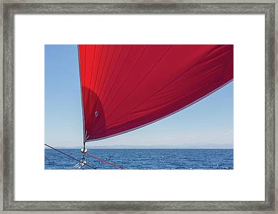 Framed Print featuring the photograph Red Sail On A Catamaran 2 by Clare Bambers
