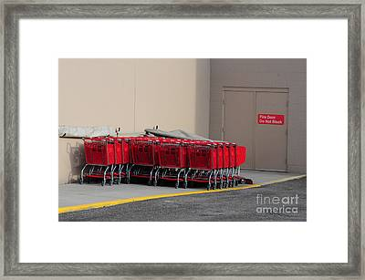 Red Shopping Carts In A Row Framed Print by Merrimon Crawford