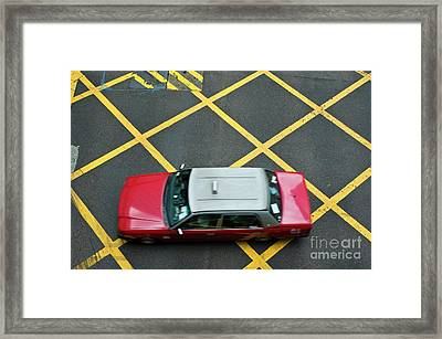 Red Taxi Cab Driving Over Yellow Lines In Hong Kong Framed Print by Sami Sarkis