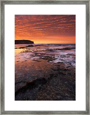 Red Tides Framed Print by Mike  Dawson