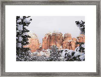 Red Towers Under Snow Framed Print
