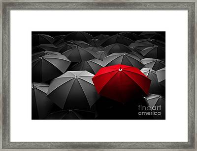 Red Umbrella Stand Out From The Crowd Of Many Black And White Umbrellas Framed Print