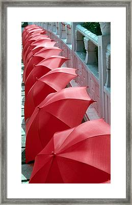 Red Umbrellas Framed Print by Douglas Pike