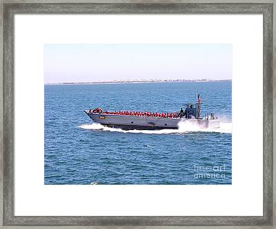 Red Vests Skimming To Work Framed Print by David Bearden