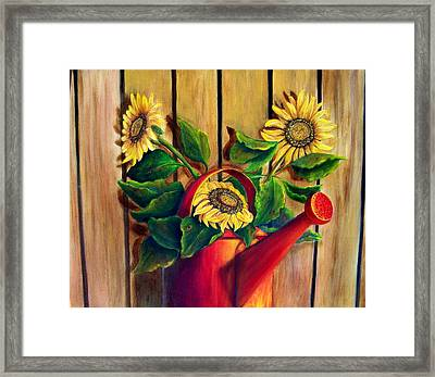 Red Watering Can With  Sunflowers.  Sold Framed Print