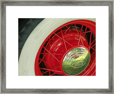 Red Wheels Framed Print by Richard Mansfield