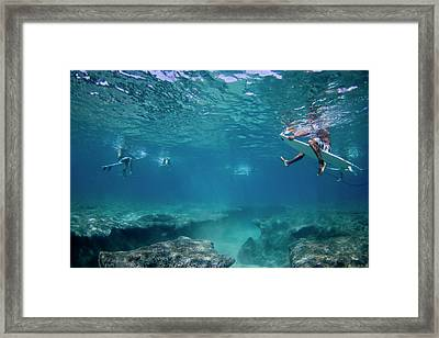 Reef Surfers Framed Print