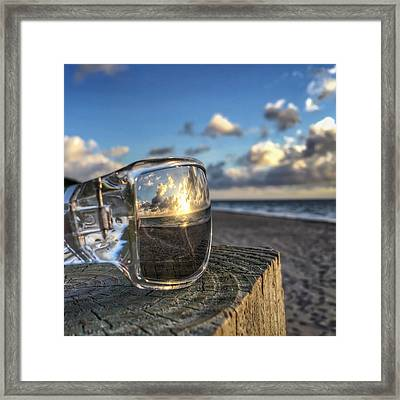 Reflecting Sunglasses Framed Print