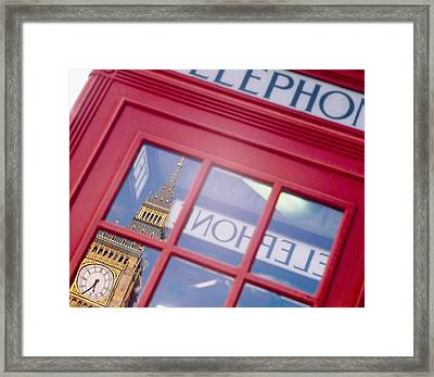 Reflection Of A Clock Tower Framed Print
