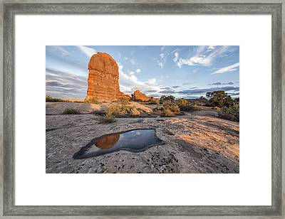 Reflection Of Arches Framed Print by Jon Glaser