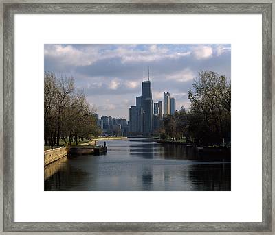 Reflection Of Buildings In A Lagoon Framed Print