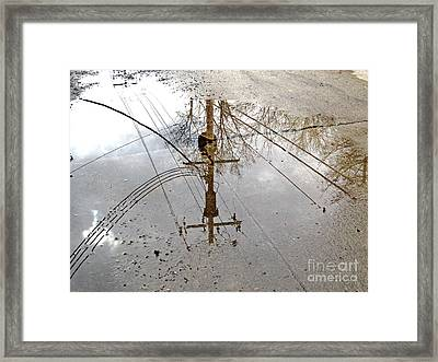 Puddle Reflections  Framed Print