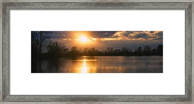 Reflection Of Sun In Water, West Framed Print by Panoramic Images