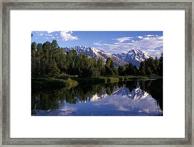Reflection Of The Teton Mountans Framed Print by Richard Nowitz