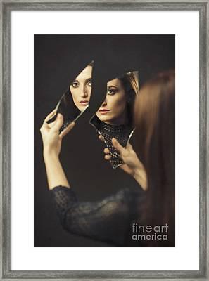 Reflection Of Woman In Broken Mirror Framed Print