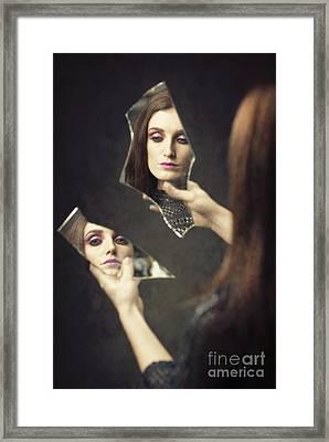 Reflection Of Woman In Broken Mirror Shards Framed Print