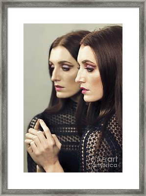 Reflection Of Woman In Mirror Framed Print