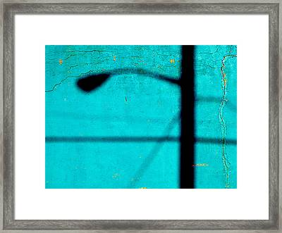 Reflection On A Blue Wall Framed Print by JoAnn Lense