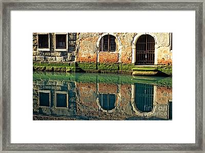 Reflection On Canal In Venice Framed Print by Michael Henderson