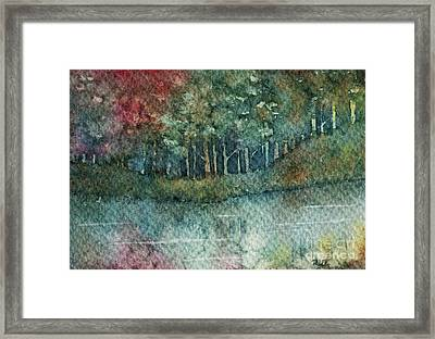 Reflections Along The Water Framed Print