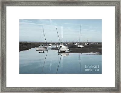 Reflections At Brancaster Staithe Norfolk Framed Print by John Edwards