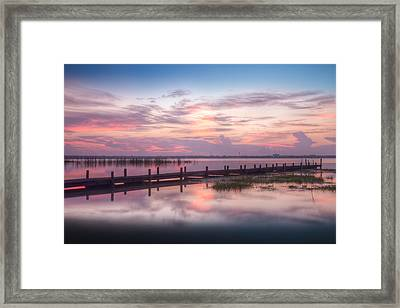 Reflections At The Dock Framed Print by Debra and Dave Vanderlaan