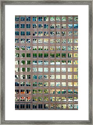 Reflections In Windows Of Office Building Framed Print