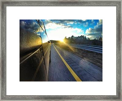 Reflections On The Turnpike Framed Print by Erik Kaplan