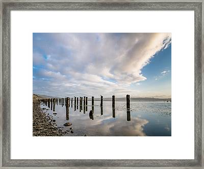 Reflections Pylons Clouds Framed Print by Greg Nyquist