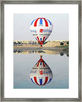 Reflective Balloon Framed Print by Graham Taylor