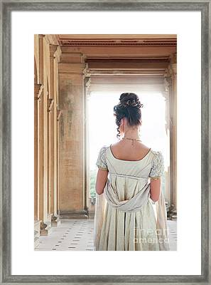 Framed Print featuring the photograph Regency Woman Under A Colonnade by Lee Avison
