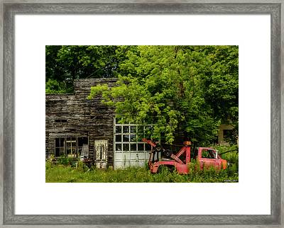 Remains Of An Old Tow Truck And Garage Framed Print by Ken Morris