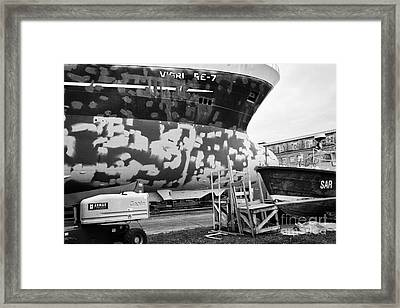 Repairing And Painting Hull Of A Ship In Dry Dock In Reykjavik Harbour Iceland Framed Print