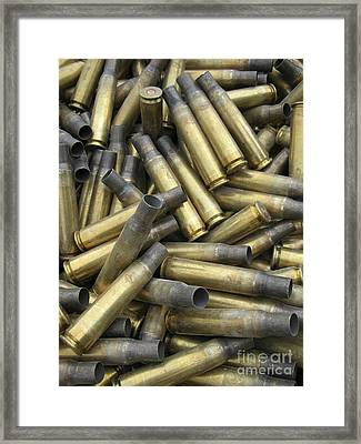 Residual Ammunition Casing Materials Framed Print by Stocktrek Images