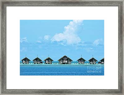 Resort Bungalows Over Sea Framed Print by Sami Sarkis