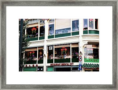 Restaurant Oriental City Framed Print by John Rizzuto