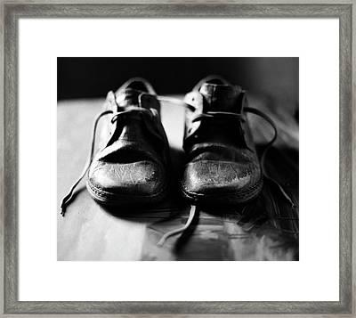 Retired Old Shoes Framed Print