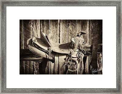 Retired Saddle Framed Print by Christine Hauber