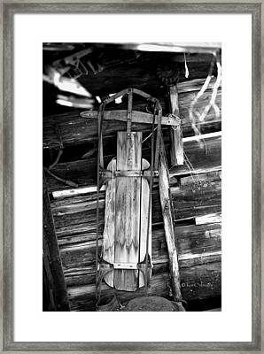Retired Snow Sled Framed Print