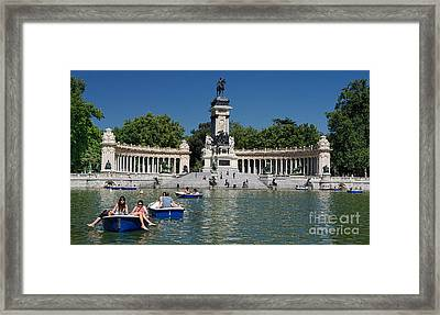 Framed Print featuring the photograph Retiro Sunday by Nigel Fletcher-Jones