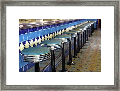 Retro Diner Stools Framed Print by Maria Dryfhout