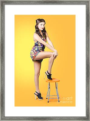 Retro Fashion Image. Woman Posing As A Pin-up Girl Framed Print