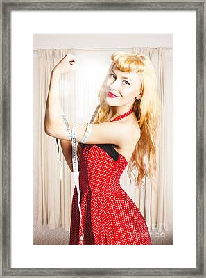 Retro Pin-up Woman With Measured Strength Framed Print