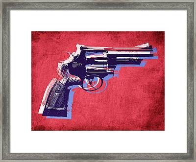 Revolver On Red Framed Print by Michael Tompsett